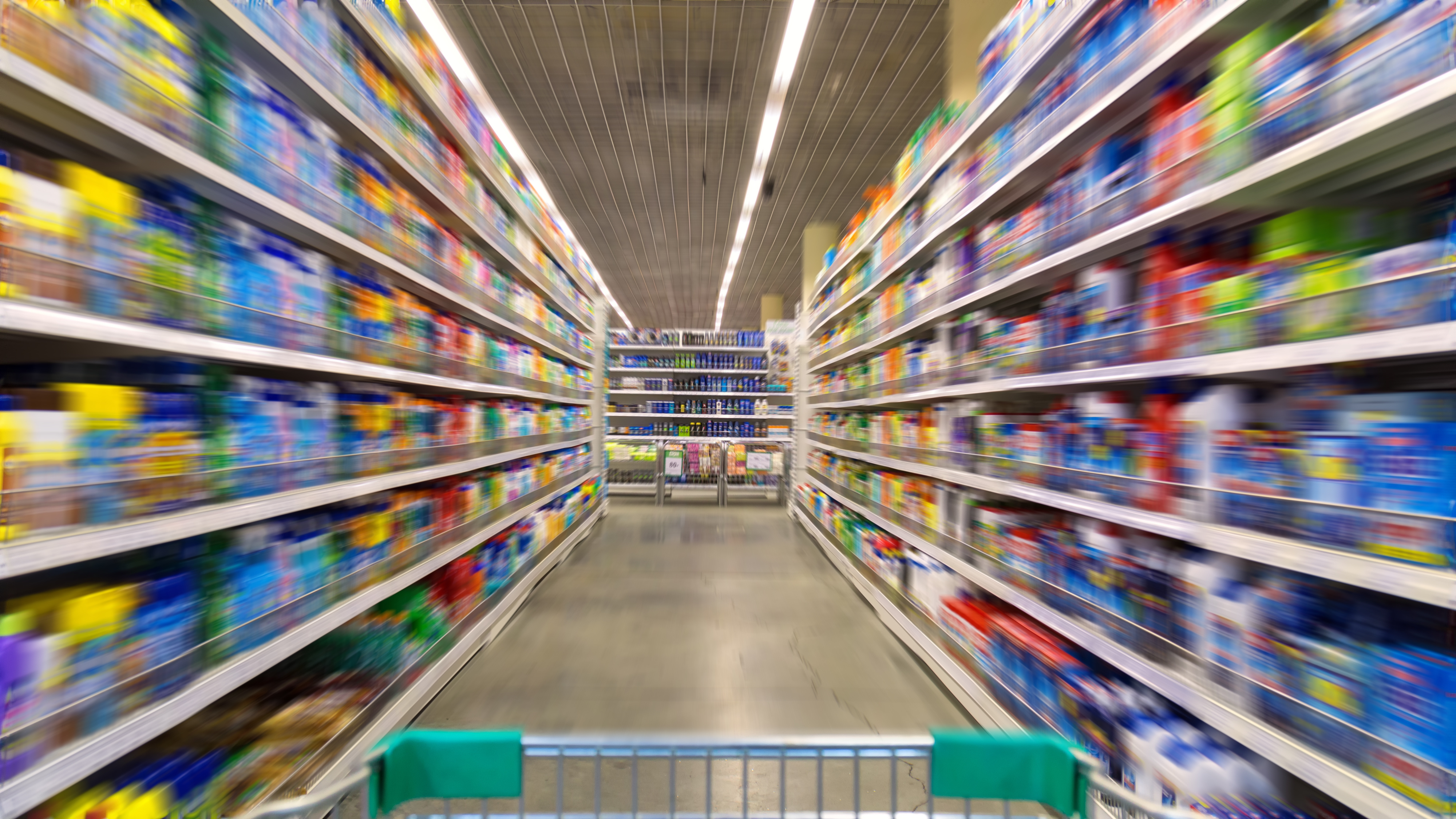 Shopping Cart View on a Supermarket Aisle and Shelves – Image Has a Shallow Depth of Field